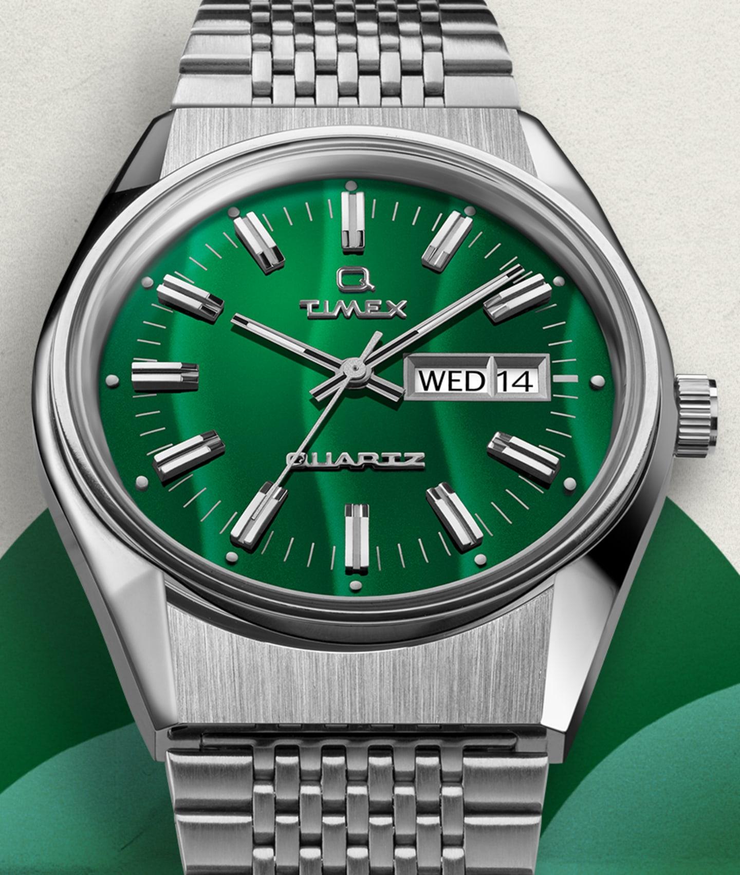 Q Falcon Eye Green Dial Watch.