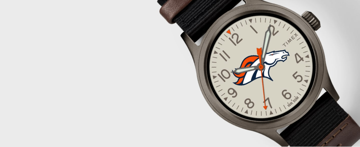 Packers Watch With Green Straps With Logo In Center And Black Steelers Watch With Logo In Center And Grey Broncos Watch Logo In The Center Along With Brown Leather Straps
