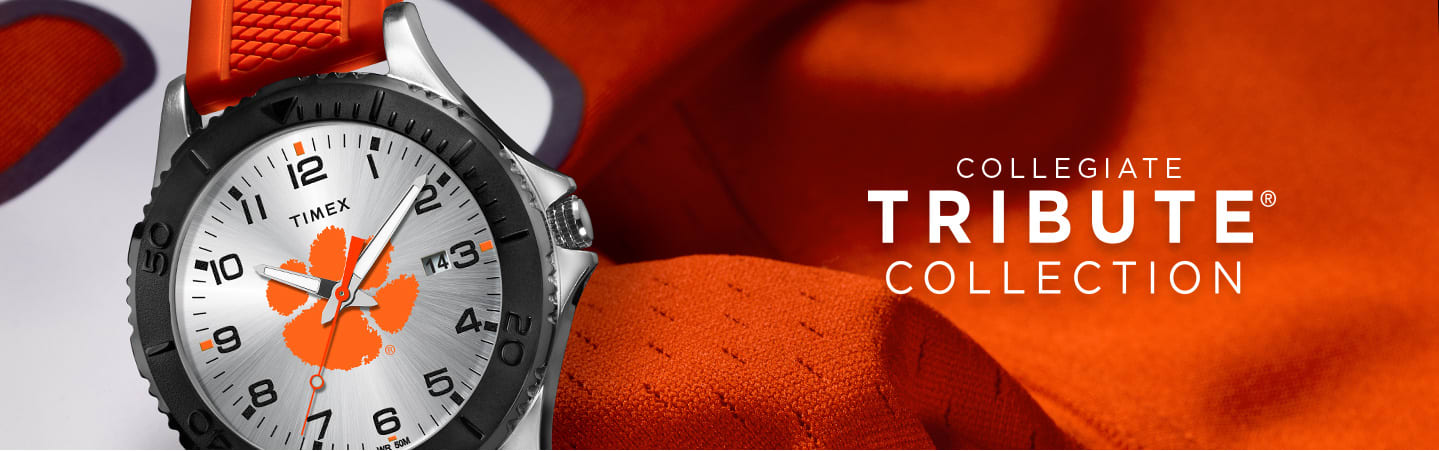 Clemson Silver Watch With Orange Straps On Top Of Orange Jersey Next To Header Saying Collegiate Tribute Collection