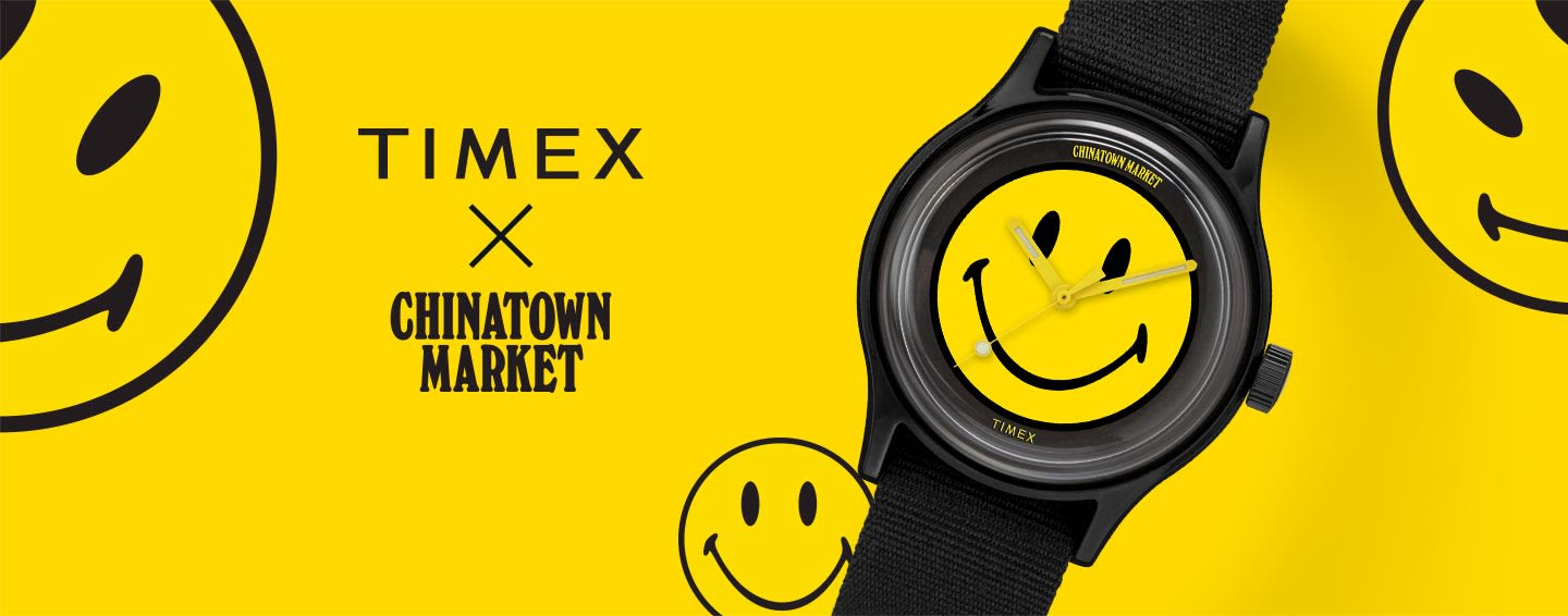 Black Chinatown Market Watch With Yellow Smiley Face Laying The Center