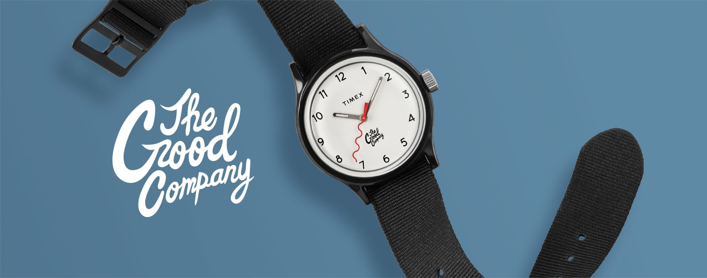 All Black Watch By The Good Company With Red Dial Spread Out On Blue Background