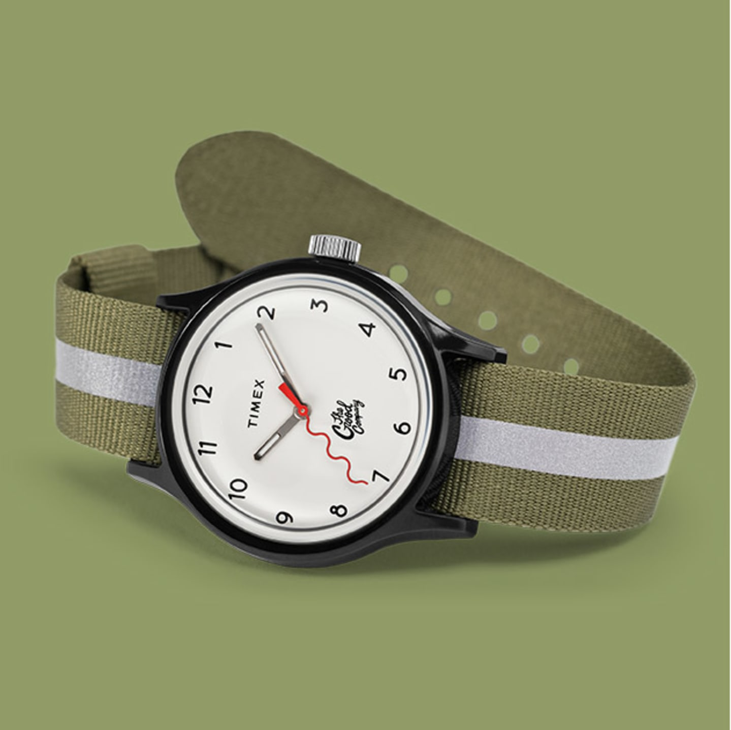 Green and White Strapped Black Body Watch By The Good Company With Red Dial