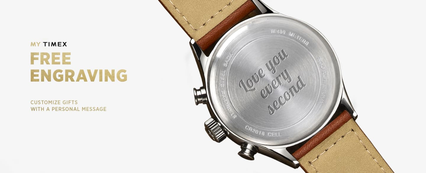 "Back of silver watch with brown leather straps with engraving in it saying ""Love you every second'"